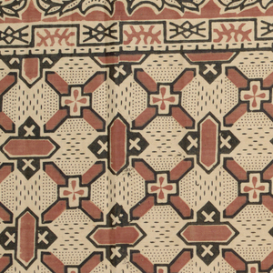 Terra cotta and black on a light tan ground with geometric design. Two edges hemmed.