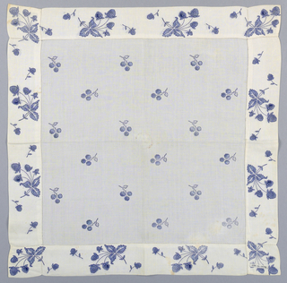 Woman's white handkerchief with a printed design of blueberries and leaves in blue with dark blue outlines.