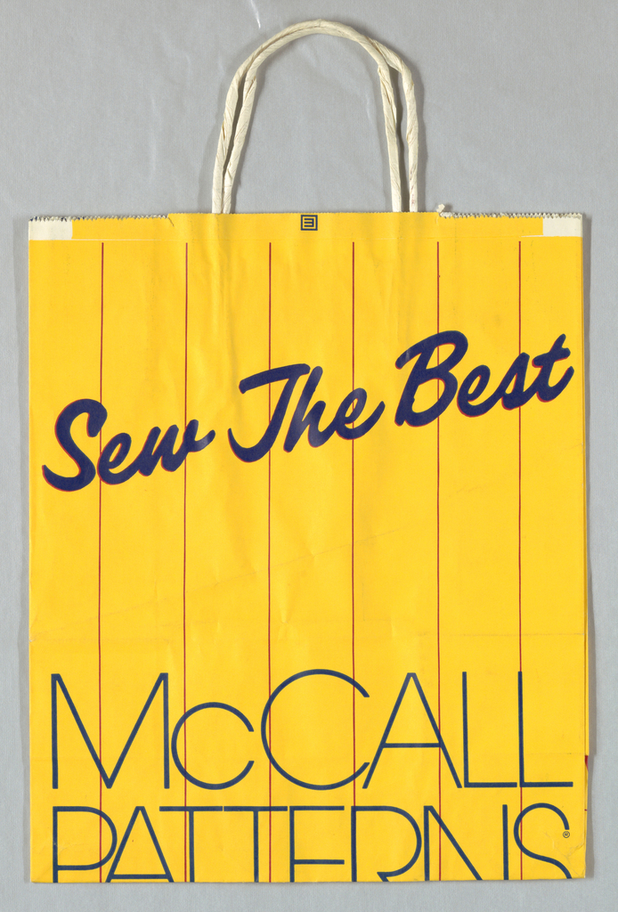 "Yellow paper bag with red vertical stripes; ""Sew the Best"" at top diagonally in blue cursive font with red shadow; ""McCALL/PATTERNS"" in blue centered at bottom. Design continues in side panels, with firm name in red."