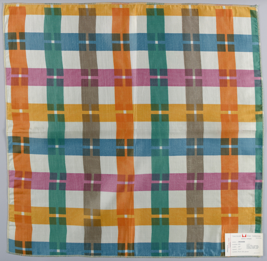 Interrupted stripes in vertical and horizontal directions printed in green, blue, grey, orange, and pink. All four sides are serged.