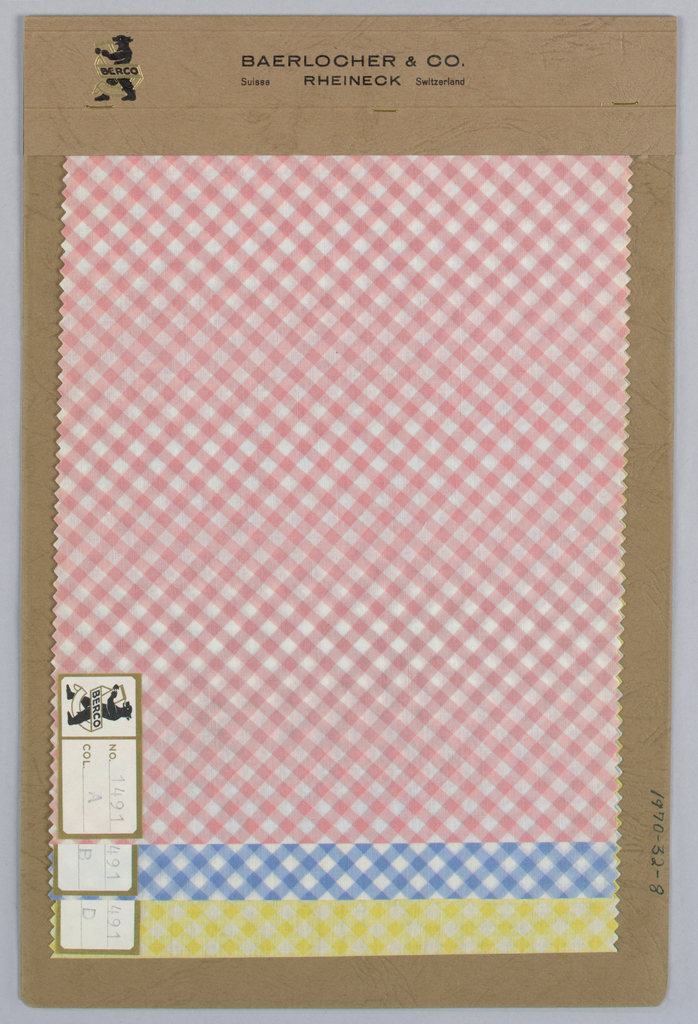 Three samples of diagonal checkered fabric in pink, light blue and yellow. Bound in paper with acetate cover.