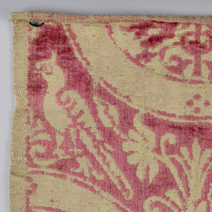 Addorsed animals within circles and confronted birds on top of circles in the manner of a 10-12th century fabric in beige and red.
