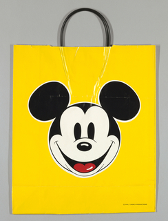 Yellow background with head of Mickey Mouse. Side panels: Marshall Field's Salutes Walt Disney World Days April 1985.