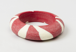 Bangle bracelet, opaque red and white.