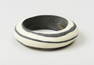 Bangle bracelet, opaque black and white.