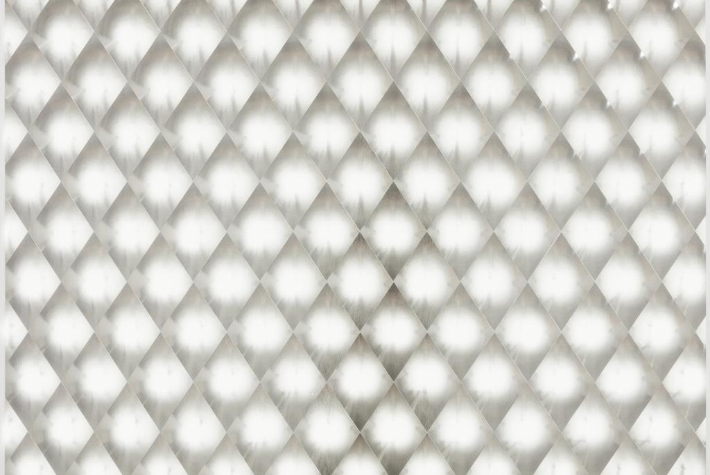 Silver hologram foil in diamond trellis pattern.