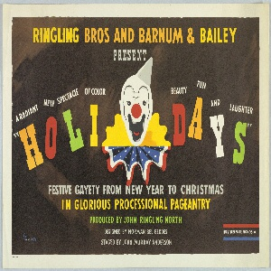 "Poster for Ringling Bros. and Barnum & Bailey advertising a special holiday show designed by Norman Bel Geddes. At center, a clown's face with a gray hat and a ruffled collar that is half yellow, half red, white, and blue (resembling an American flag). At top, in yellow and orange text: RINGLING BROS AND BARNUM & BAILEY / PRESENT [in gray]. On either side of the clown's face in white text: A RADIANT NEW SPECTACLE OF COLOR BEAUTY FUN AND LAUGHTER; below in multi-colored letters: "" H O L I D A Y S "". Below, in gray, yellow, and green text: FESTIVE GAYETY FROM NEW YEAR TO CHRISTMAS / IN GLORIOUS PROCESSIONAL PAGEANTRY / PRODUCED BY JOHN RINGLING NORTH / DESIGNED BY NORMAN BEL GEDDES / STAGED BY JOHN MURRAY ANDERSON. At bottom, in between a red band and a blue band, in white text: BUY DEFENSE BONDS [star]."