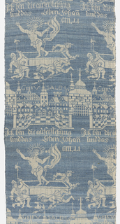 """Narrow panel of blue and white linen. Design in horizontal rows, two motifs repeating alternately: a walled city with the inscription """"Gerusalem,"""" and the Resurrection with the inscription, """"ich bin die auferstehung und das Leben Johan am 11"""" (I am the Resurrection and the Life, John chapter 11)  """"R"""" embroidered in red linen cross-stitch in the lower right corner. Triangular pocket of same material on back at lower edge."""