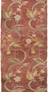 Fragment of russet damask weave silk brocaded in silver with yellow and white silk, showing floral design in the 'bizarre' style.