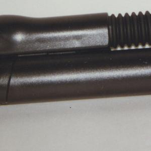 Black plastic L-shaped housing with clear, rectangular lense on flexible, black plastic segmented tube with black plastic base.