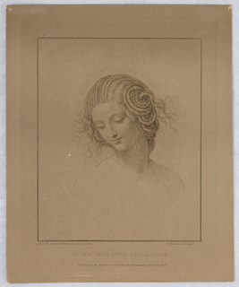A young woman, with her hair coiled in braids looks down slightly toward the left.