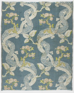 Patterned silk with a blue ground and an 'S' curve element of a flowering branch intertwined with a ribbon of lace.