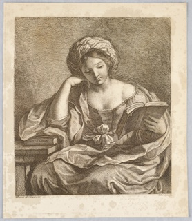 """A woman sits at a table, her elbow on the table at left, resting on a book with """"SIBILEA LIBIA"""" written on its spine. In her left hand she holds another book, open."""