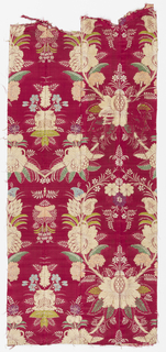 Crimson satin ground with a symmetrical repeat of large attenuated floral ogives in greens, pale blue, mauve, light orange, yellow, and beige. Smaller symmetrical bouquets in interstices. Motifs woven first in crimson plain weave on the satin ground; then above colors introduced in certain areas.