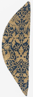 Fragment of woven silk with a deep blue ground and design in metallic gold. Addorsed griffons surrounded by  vines and grape leaves.