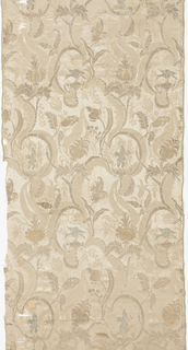 Beige silk brocaded with gold and silver metallic thread and blue and orange/tan silk in a pattern of vines with flowers and animals.