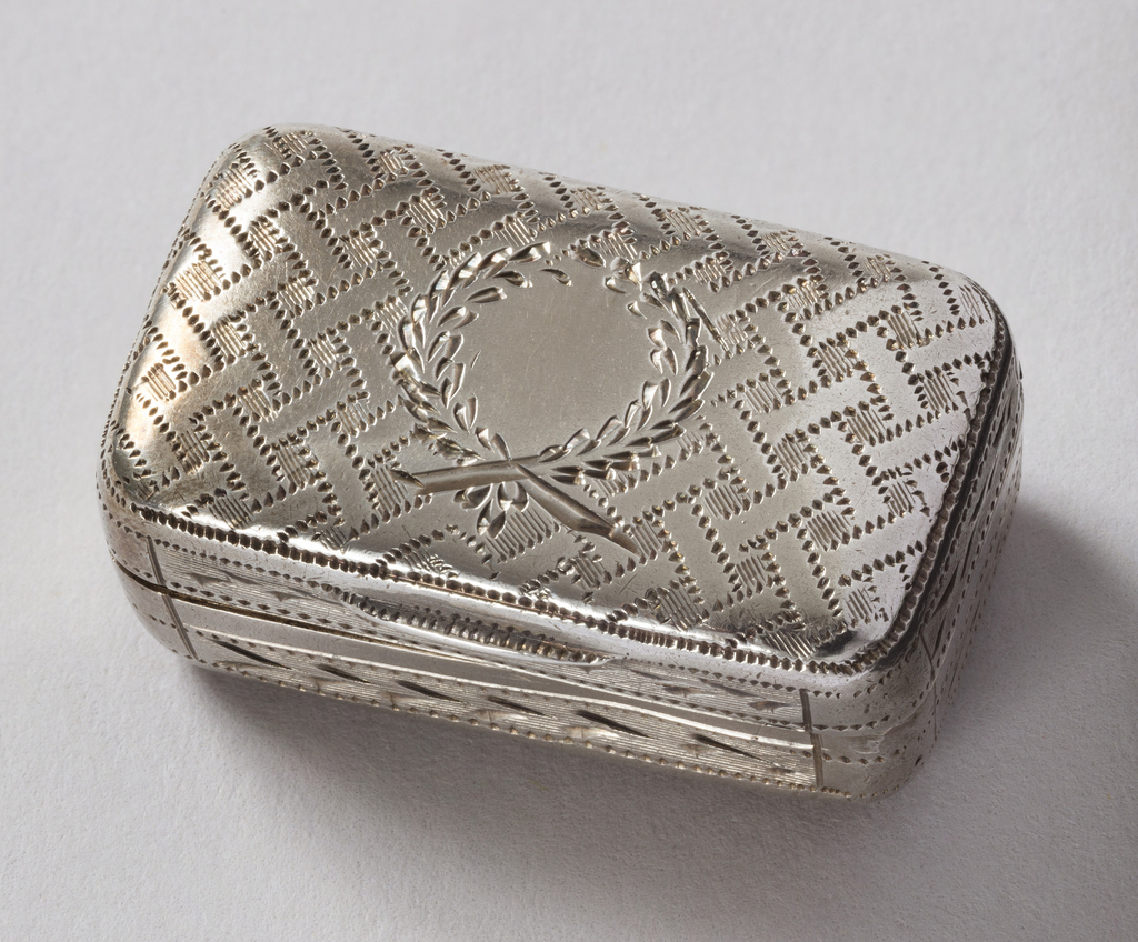 Rectangular box with hinged cover; top and bottom has stipple-engraved basketwork pattern, with wreath in center of top. Inside gilt, with flower-engraved and pierced second cover hinged to short side.