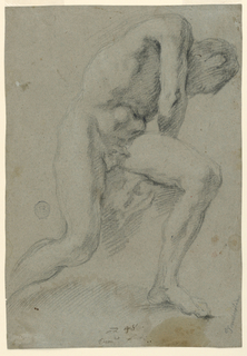 Right side view of male nude kneeling on right knee.