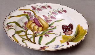 A plate with a wavy, brown-edged rim, painted with a papaya (Carica papaya), two sprays of flowering millet grass, and several insects.