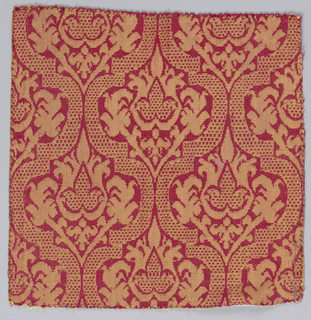 Bands of checkerboard form of ogives containing blossoms and leaves in red and yellow silk.
