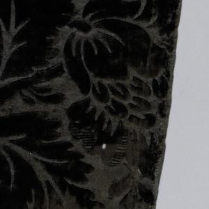 black figured velvet [probably dyed] - design showing all-over floral designs - selvage present