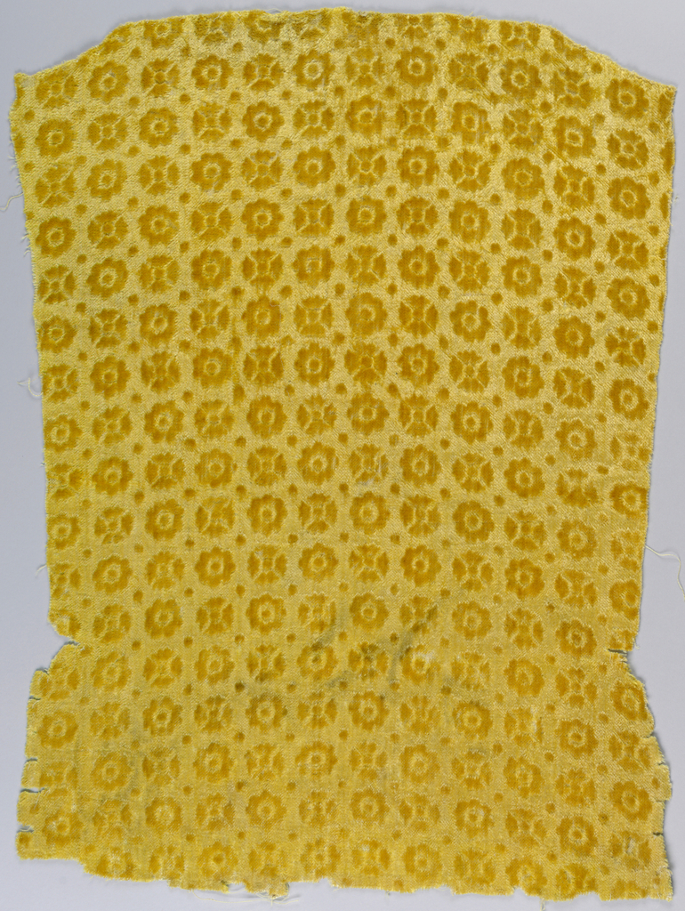 Flower shapes in relief against a pressed background. The illusion of two colors is given because part of the pile has been flattened. In strong yellow.