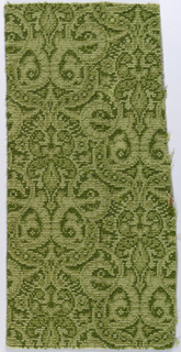Brussels-style carpet fragment with pattern of dense allover interlace with medallions. In shades of olive green.