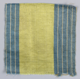 Fragment with vertical stripes of yellow and blue.