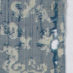 Diagonally slanting floray scrolls and tiny sea creatures in blue and white.