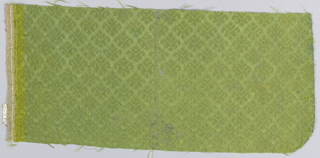 Small detached motifs in green.  Selvage at one side.