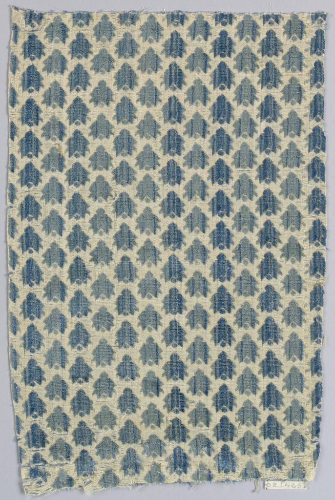 Blue-green detached leaf motifs on beige foundation.