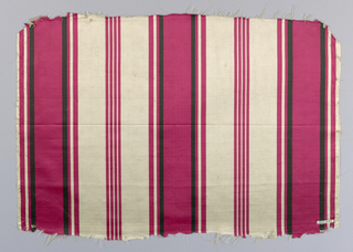 Fragment of upholstery fabric in red, black and white stripes.