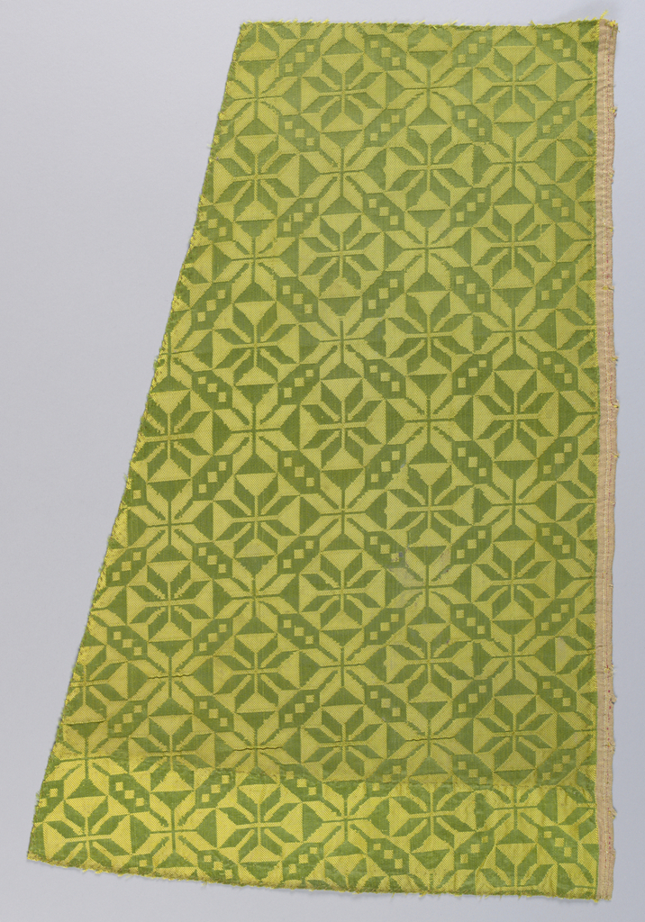 Star motif in green and gold. Selvage at one side.