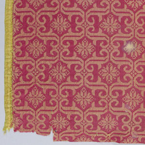 'S' curves in rectangular arrangement frame rosettes. In red and yellow.