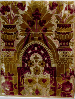 This fragment preserves only a section of a much larger pattern.  The design is in olive green and deep red cut and uncut velvet on cream satin ground.  The upper portion of an arch, its supporting pillars, and large vase forms and large scale floral above the arch.  This piece sewn together with 1948-116-2-a,b.  Right selvedge present.