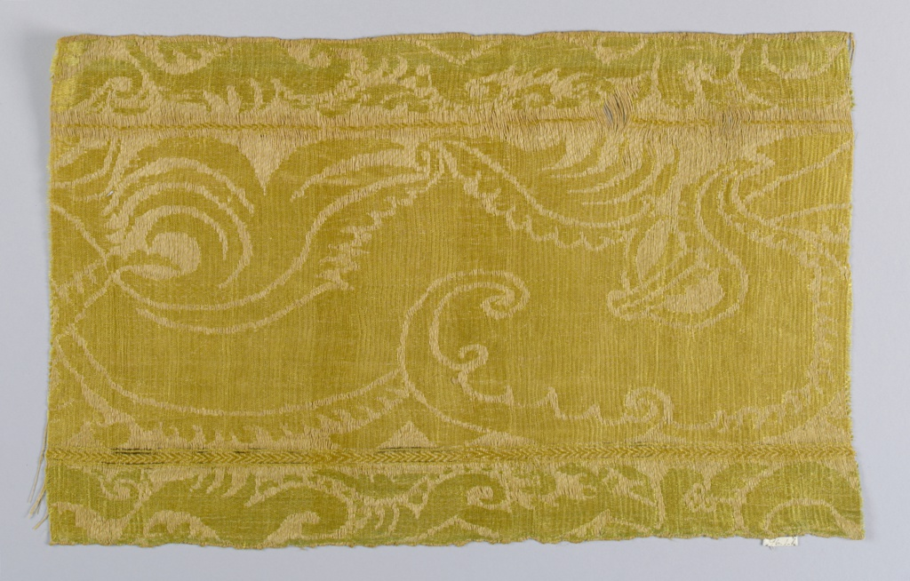 Yellow and green with a swan and water motif.
