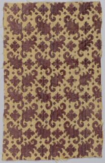 Stylized leaf forms turning alternately left and right in horizontal rows with small quatrefoil form between them. Pattern in purple cut and uncut pile on tan ground shot through with metal strips.