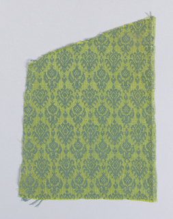 Repeat of small symmetrical sprigs with two variations of a pomegranate and leaf motif in alternate rows. One very narrow selvage.