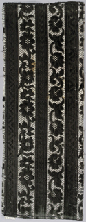 Stripes of black alternate with floral trails all in black on a background of white twill formed by supplementary wefts.