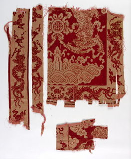 Red and beige velvet fragments with dragons, Fu dogs, clouds, and flowers.