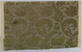 Selvage to selvage width with a design of dark brown scrolling leaves and flowers facing in alternate directions.