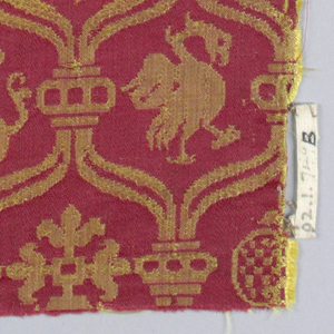 Red and yellow damask with heraldic animals in small cartouches.
