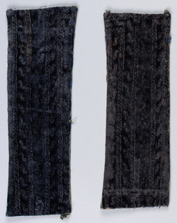 Deep purple fragments that once formed part of a stole have a stamped pattern of narrow vertical bands containing small scrolls.