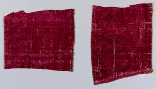 Embossed pattern of interlaced straps on red velvet.
