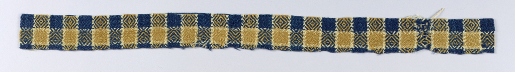 Check of alternating dark blue and warm tan stripes in both the warp and weft, with off-white accents. Diamond or birds-eye twill effect in woven pattern.
