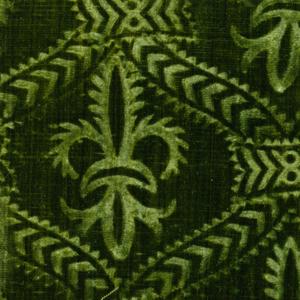 Stamped pattern of fleur-de lys within a trellis in green velvet