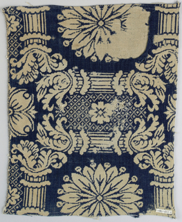 In navy wool and cream cotton, large ornate pattern of acanthus pillars framing large rosettes, with thistles and branches and some diaper filling.