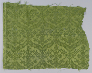 Dark yellow-green damask with medium-sized tangent ogives in horizontal rows with stylized symmetrical vase-and-flower motif in center of each.