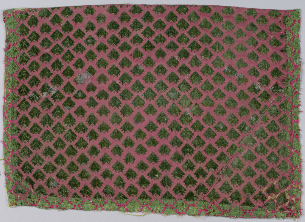 Twice colored silk velvet with detached leaf pattern in green cut pile on a red background W: 0.23.5 (9 1/4) L: 0.35.5 (14) Ex Vives Coll.