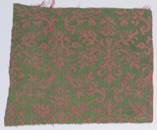 Formal pattern of pomegranate shapes and leaf sprigs in red and green.